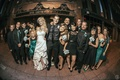 Teal and black bridesmaids and groomsmen in front of Belasco theater