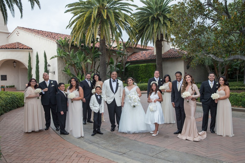 4a2c7aa9478 Bride and groom with bridesmaids in tan taupe gowns groomsmen in tuxedos  groom in white tuxedo