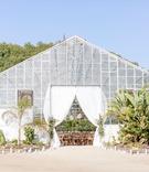 Dos Pueblos Orchid Farm in santa barbara area venue greenhouse white drapery landscaping desert chic