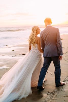 wedding portrait photo ideas couple walking on beach bride with long hair curls custom trish peng