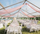 outdoor wedding reception, tented wedding, clear tent decorated with blush fabric