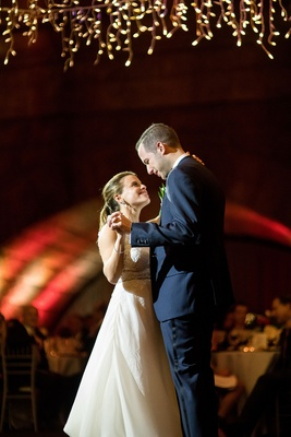Wedding reception in new york city archway icicle lights twinkle lights romantic first dance