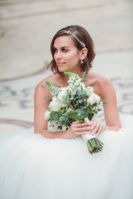 Bride in a strapless Anne Barge gown with tulle skirt, rhinestone headband, diamond drop earrings