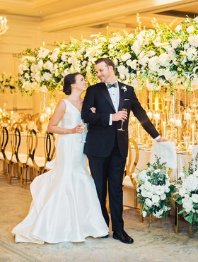 atlanta wedding ballroom reception bride in sareh nouri groom in tuxedo white greenery gold decor