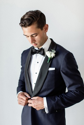 groom in suitsupply navy tuxedo with rounded black lapels