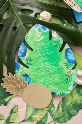 Palm tree leaf shape tropical menu card and pineapple rehearsal dinner invite enclosure gold green