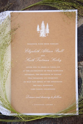 Wedding invite on natural paper with white lettering