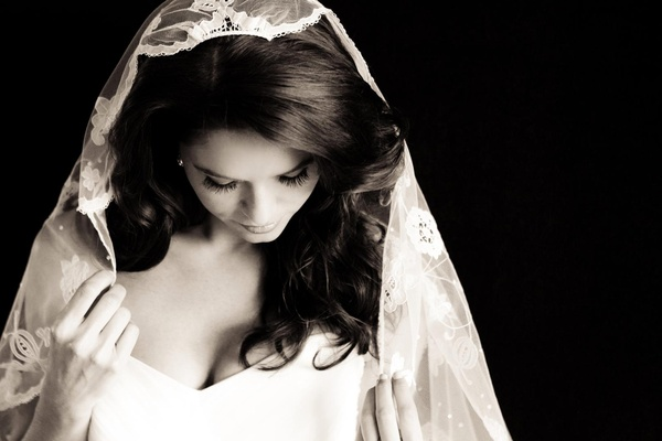 bride wears a lace mantilla veil