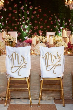 Gold chairs in Mediterranean ballroom at The Breakers on white chair covers laser cut signs