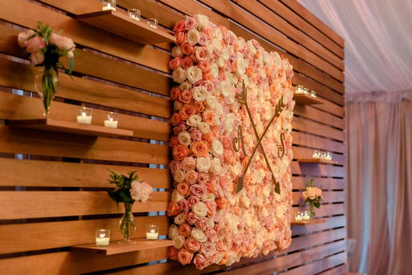 Wedding reception wood planks floating shelves flower wall with monogram and crest