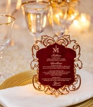Gold charger plate white napkin burgundy menu card elegant details
