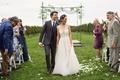 Lyndsy Fonseca and Noah Bean wedding walking up aisle in vineyard ceremony guests and family happy