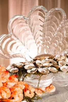 Shrimp and oysters seafood on clam shell ice sculpture