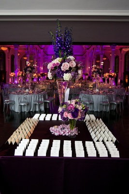 White cards on square table with tall centerpiece