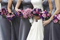 Bride with bridesmaids holding purple bouquets