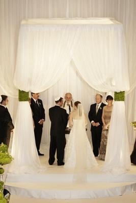 Jewish wedding chuppah with white drapery
