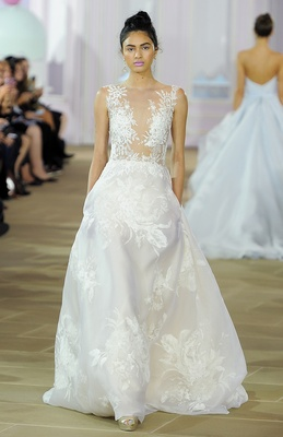 Sleeveless A-line gown with lace illusion bodice and printed Silk Organza skirt with pleats.
