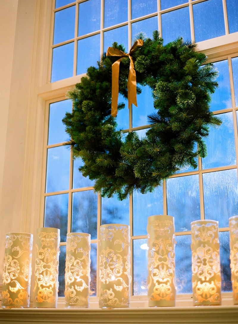 Christmas wreath and laser-cut candles at wedding