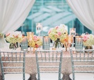 long table sequin pink champagne colored linen low pink green white floral arrangements candles
