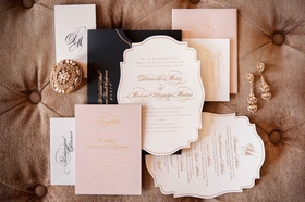 East Six wedding invitations with die cut design in white, pink, gold, and black