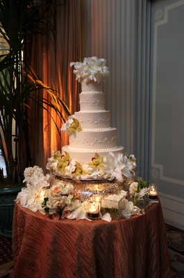 Five layer cake with lily and orchid flowers