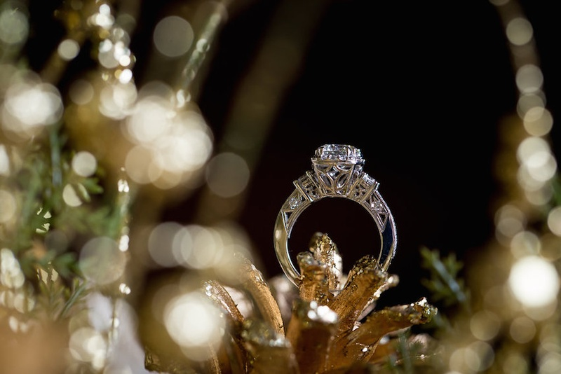 Round-stone engagement ring in golden holiday decorative basket