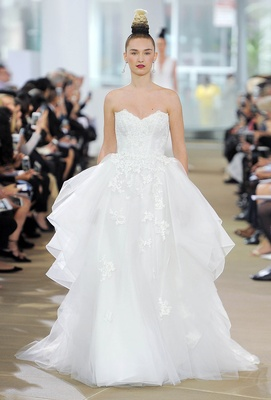 Strapless sweetheart natural waist A-line gown with side flounce and appliques throughout the skirt