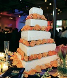 White wedding cake with orange roses