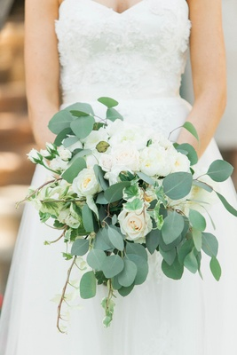 rustic bridal bouquet with ivory roses, eucalyptus, and English ivy