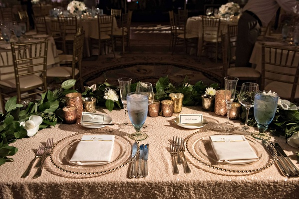 Wedding reception half moon semi circle sweetheart table greenery garland beaded charger gold votive