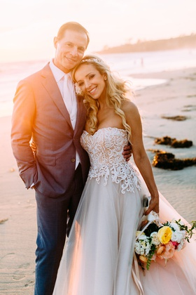bride in custom trish peng wedding dress strapless jewel headpiece headband long blonde hair curls