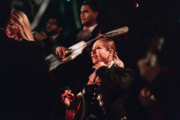 coed lgbtq mariachi group performing at wedding reception