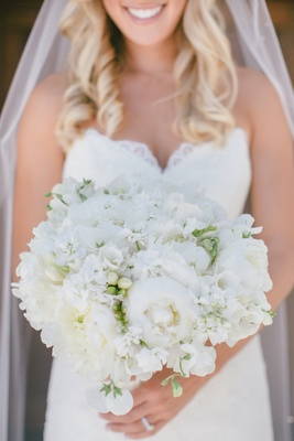 Bride's bouquet of ivory peonies, freesias, and sweet peas