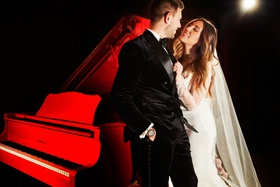 bride in vera wang wedding dress and veil groom in tuxedo chicago wedding red piano at club