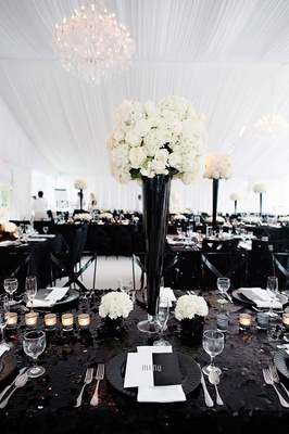 Black and white modern wedding with unique details in cincinnati black sequin tablecloth with tall black centerpiece and white flowers mightylinksfo