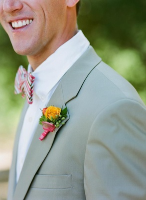 Groom wearing colorful flowers and bow tie