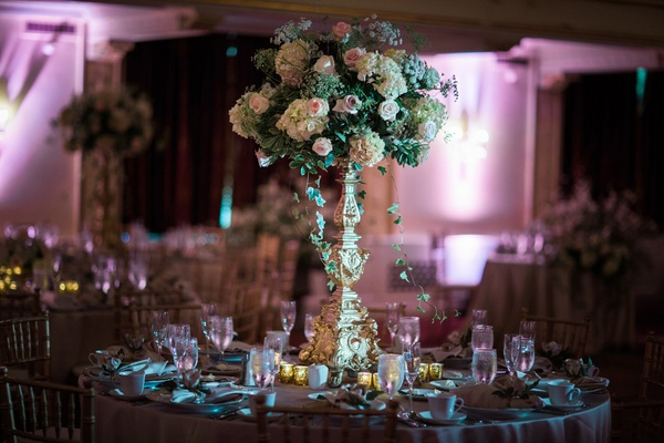 blush roses and ivory hydrangeas with greenery on golden stand