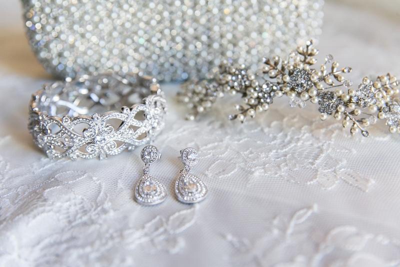 Teardrop diamond earrings and diamond cuff with headpiece