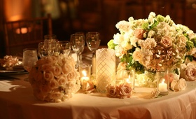 Pale pink linens and romantic floral arrangement