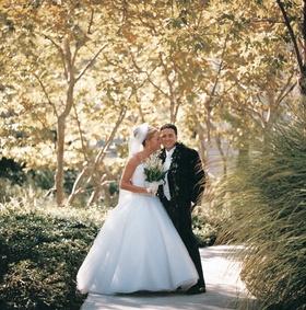 Hawaiian groom attire and bride's ball gown