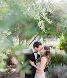 bride in monique lhuillier wedding dress kisses groom in tiger in sweden tux and yarmulke