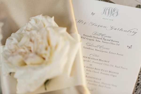 White menu with monogram and butterflies
