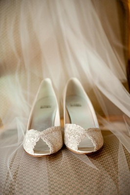 Ivory lace peep-toe heels on bridal veil