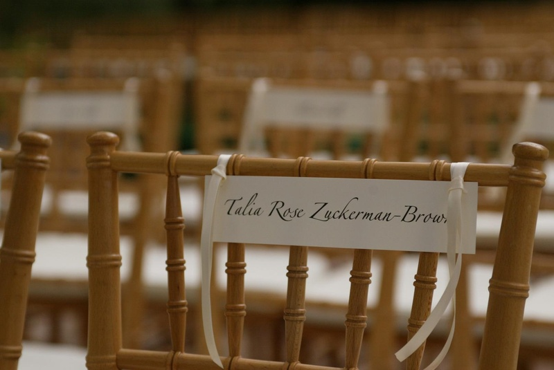 Chair assignment cards tied with ribbon