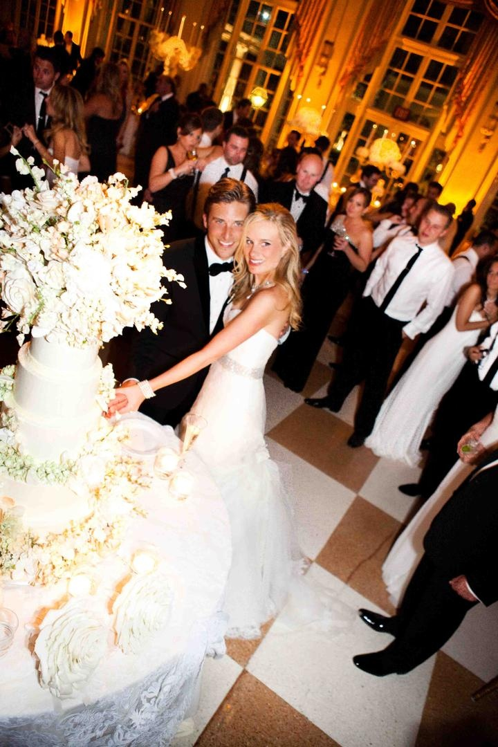 Bride and groom cut wedding cake at The Breakers