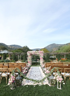 San Ysidro Ranch outdoor wedding ceremony with laser cut white aisle runner, lantern, flowers