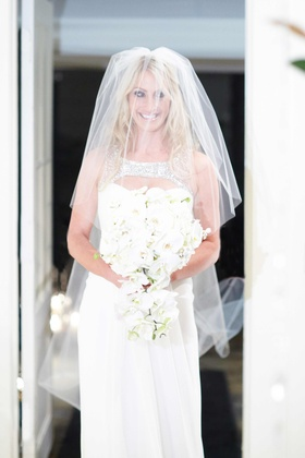 Contemporary wedding dress and orchid bouquet