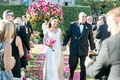 Vow renewal 30 anniversary party ceremony recessional hand in hand black double breasted tuxedo