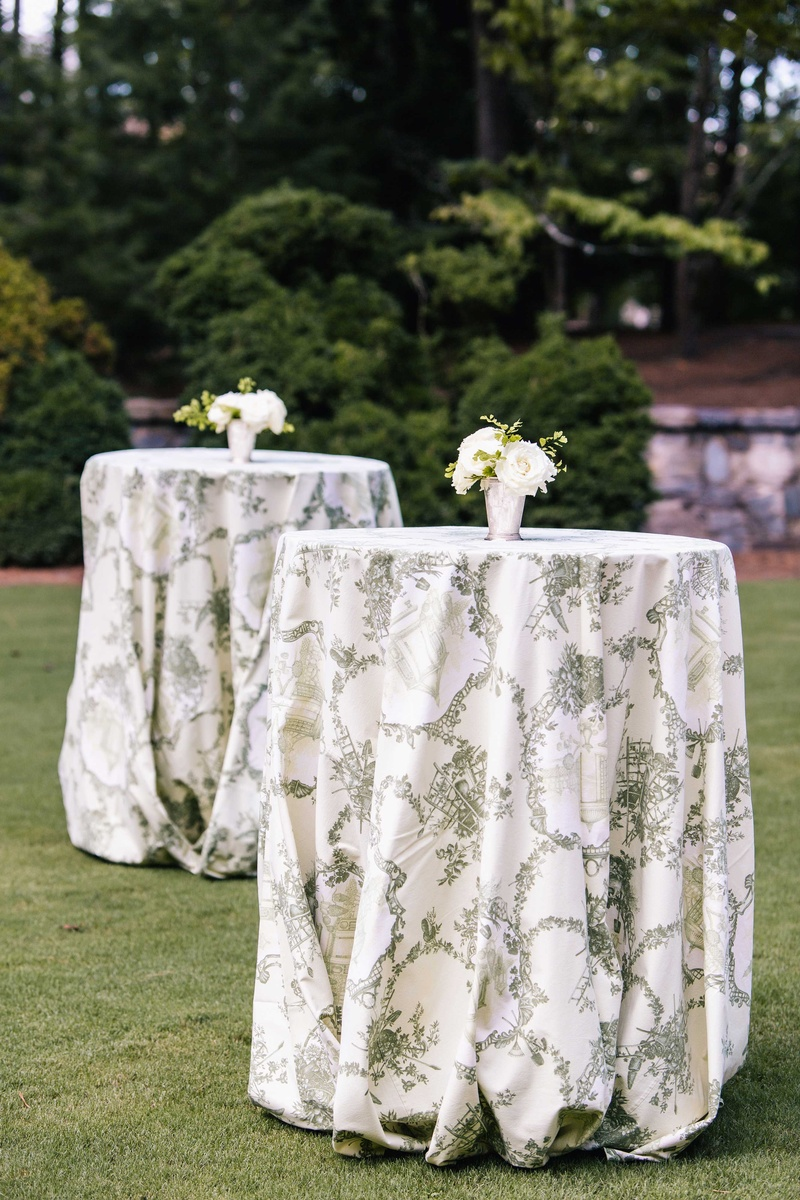 Captivating Tall Cocktail Tables On Grass Lawn With White And Green Southern Pattern  And Small White Flowers