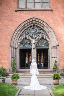 wedding ceremony venue church at high line hotel bride in lace pronovias wedding dress veil